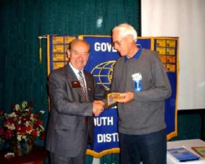 Herman Pittomvils (KI Counsellor for our district) presents Governor's patch to Tony Popplewell
